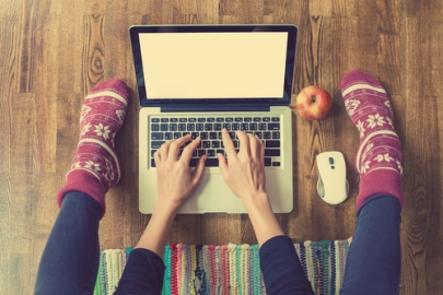 girl typing on laptop with socks